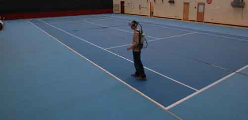 Figure 1 A test subject walking with a HMD backpack in the HIVE gym